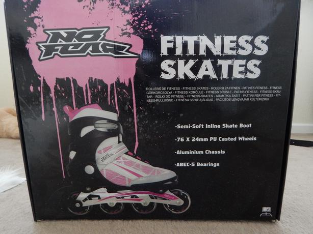 Female Skates size 4 - worn once + protectors