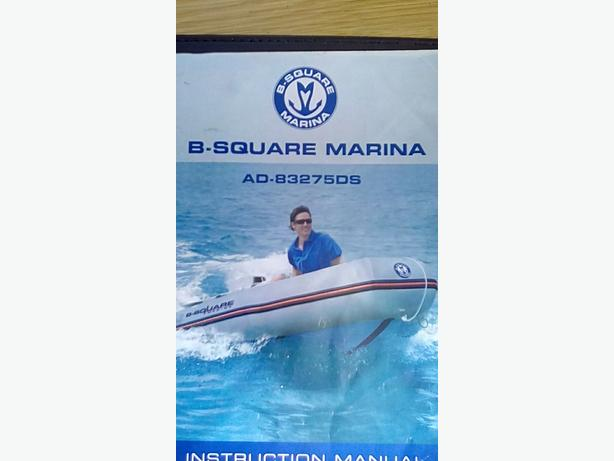 B-square inflatable dinghy and Johnson outboard motor.