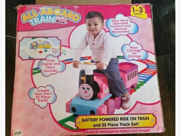 all aboard pink ride on train an track