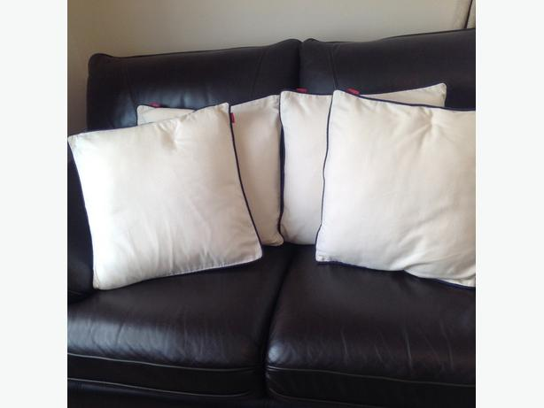 4 cream cushions from next