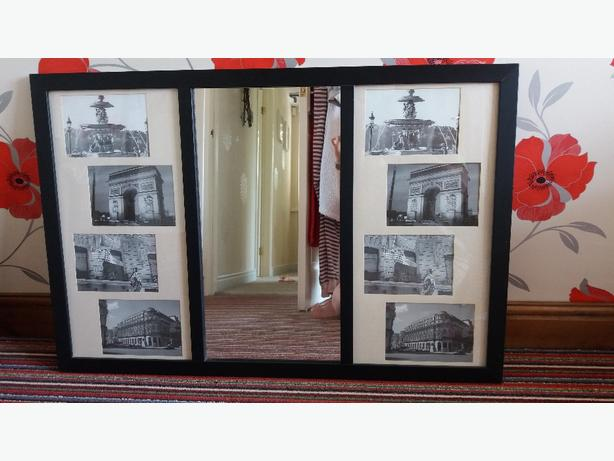 black mirror with photo frames either side