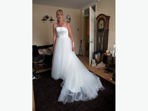 Wedding dress size 6 to 8 never worn.