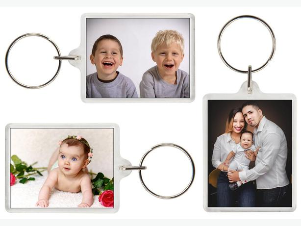 Two Photo holder key rings. (with photos of your choice).