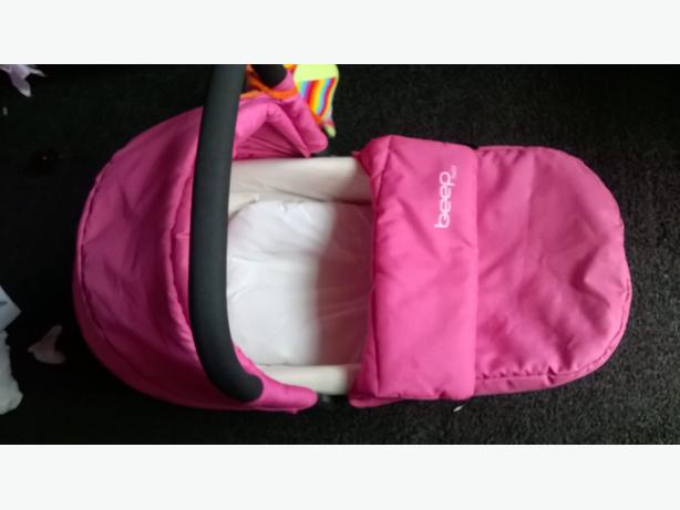 pink carry cot