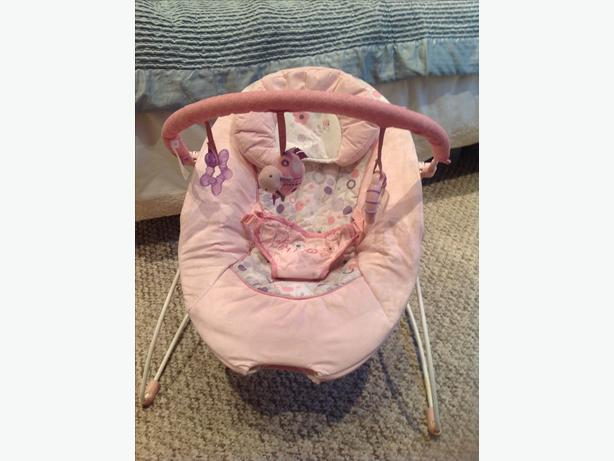 Pink baby bouncer with activity bar