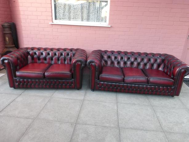 Pair of oxblood red leather chesterfield sofas