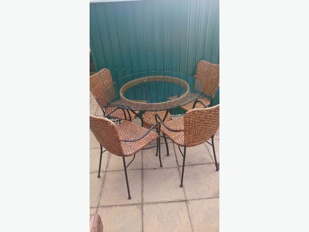 Glass topped conservatory table + 4 chairs