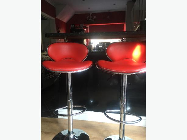 red leather cushioned bar stools
