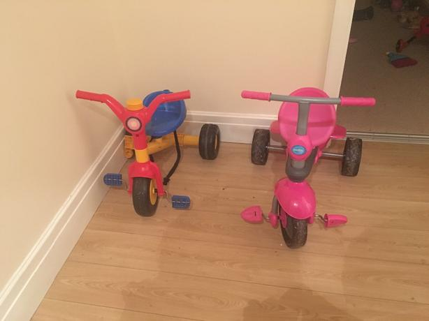 childrens small bike and pink smart trike