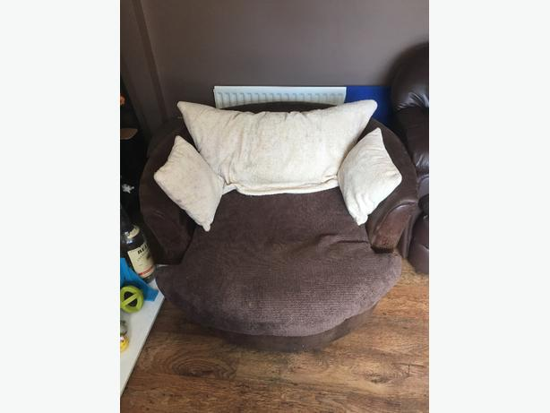 large brown swivel love chair