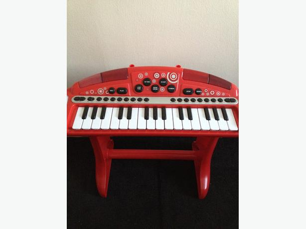 Childs red muscial keyboard