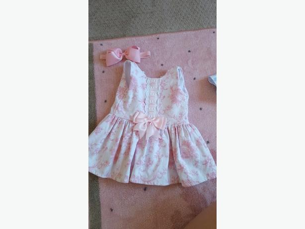 pink spanish dress with bow and socks