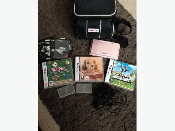 PINK NINTENDO DS + CARRIER AND GAMES