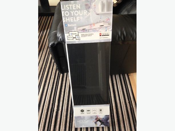 2 wireless stereo speaker shelves