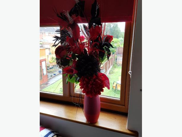 Red vase from Next with artificial flowers