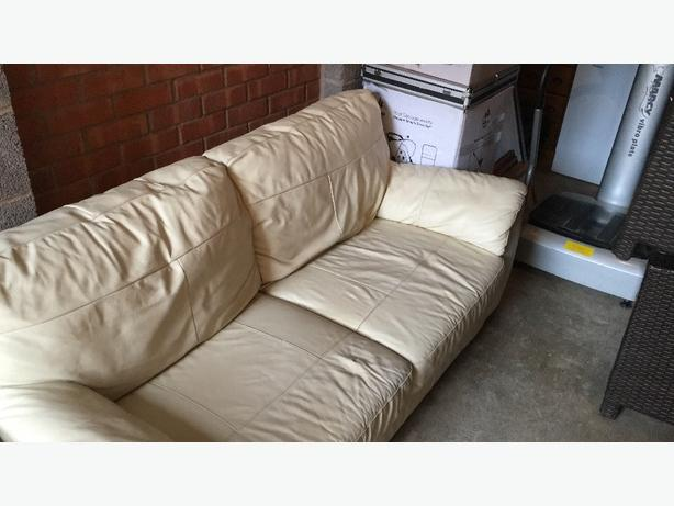 cream fuax leather sofa and chair