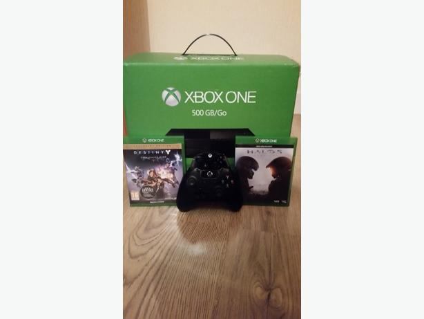 Xbox one with warranty and 2 games