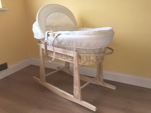 Cream waffle wicker moses basket and stand.