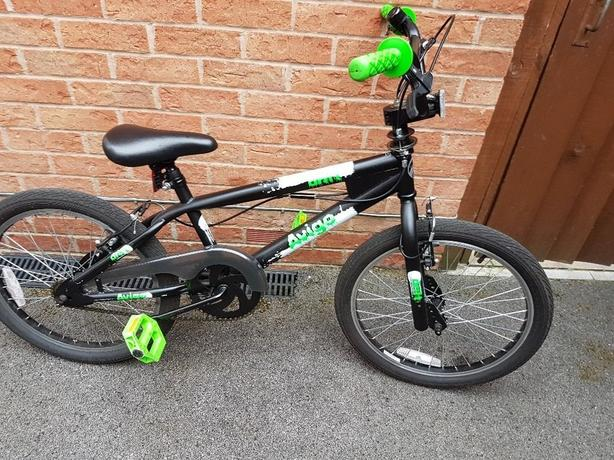 Green and black avego Bmx bike
