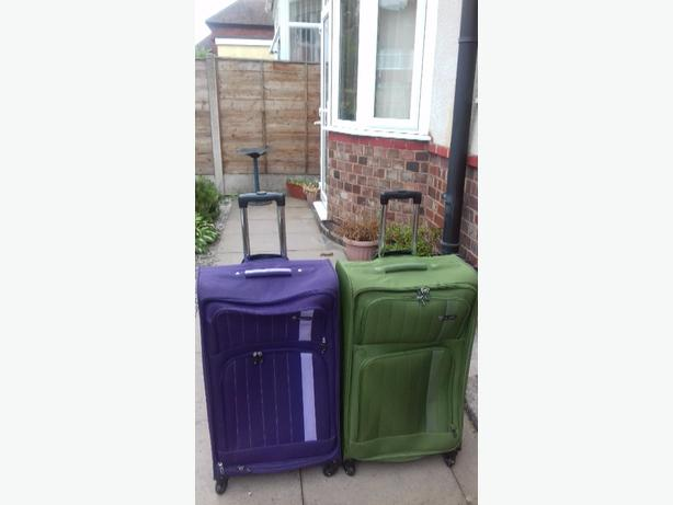 4 used luggage suitcases