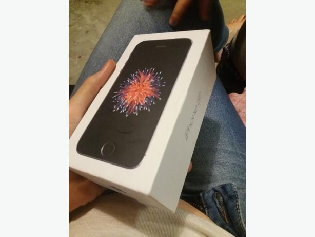 brand-new iPhone 5SE in box comes with everything