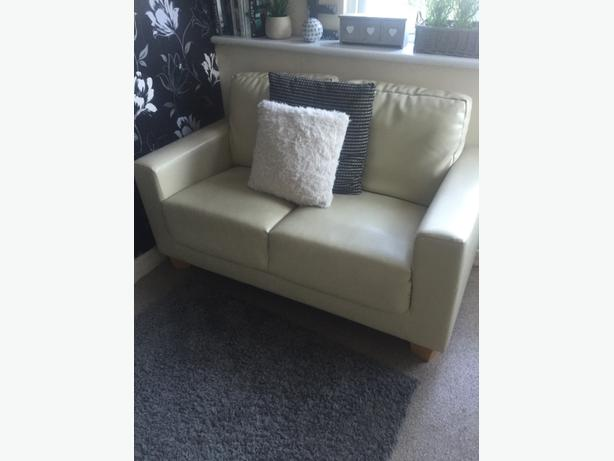 2 x 2 seater vanila faux leather sofas