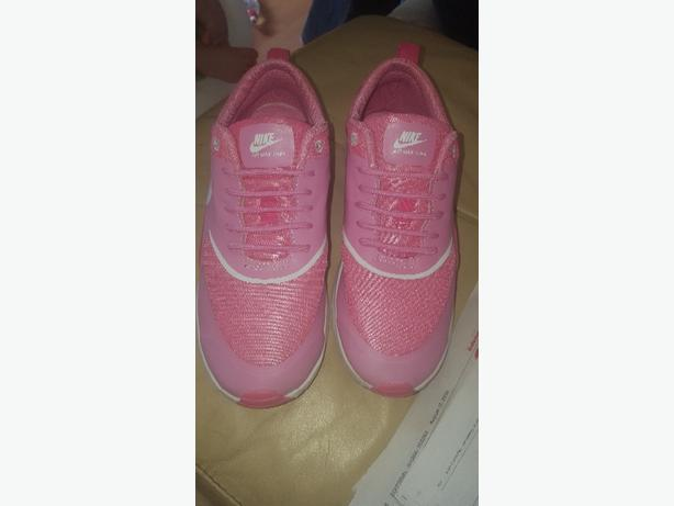 Pink and white nike trainers