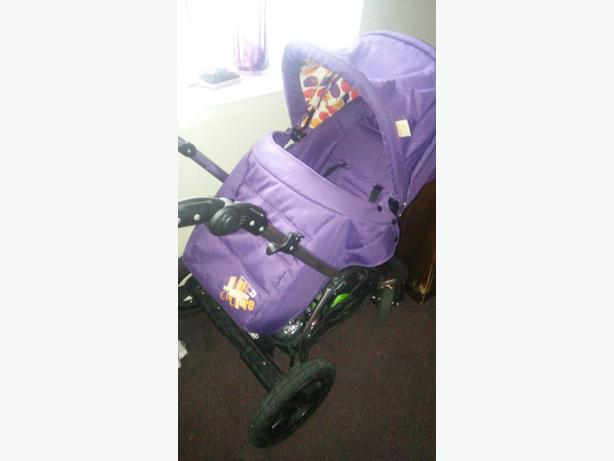 purple kiddie coture pushchair