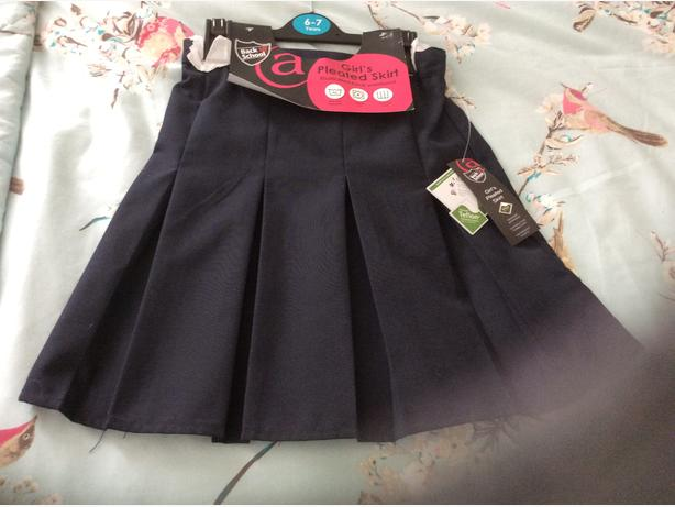 NAVY SCHOOL SKIRT AND GREY PINAFORE