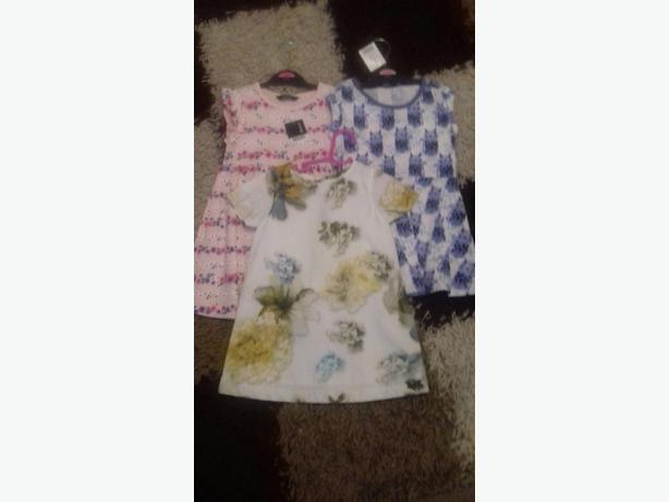 baby dresses new , coat and travel cot all new