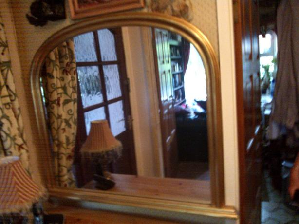 Gold framed over mantle mirror
