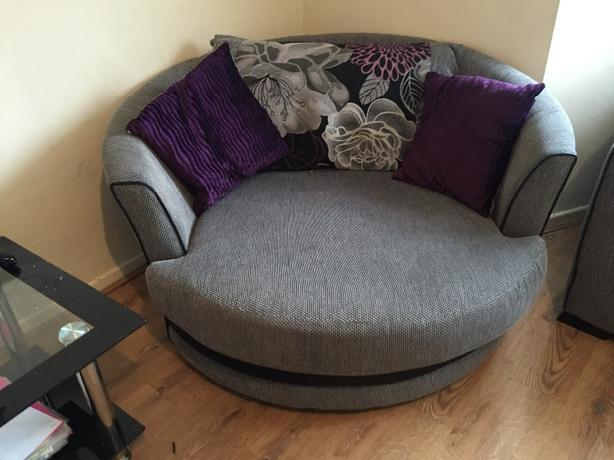 grey and purple sofa. with swivvel chair