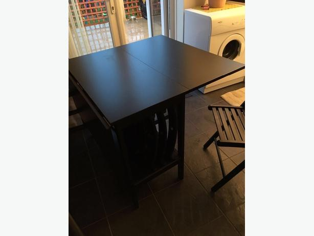 extendable black table and 6 chairs