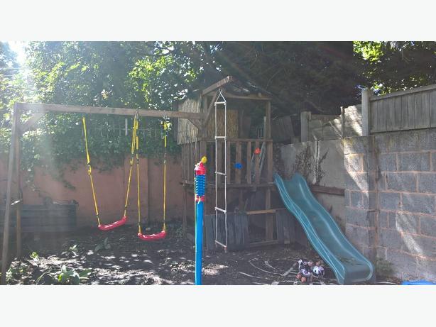 homemade swing and slide set