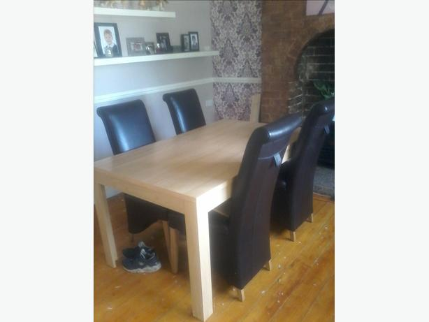 dining room table and 4 imitation leather chairs