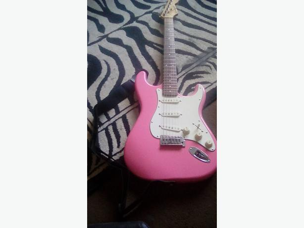 Pink electric guitar