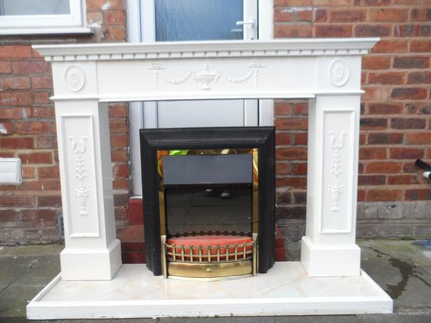 Electric fireplace and surrounds
