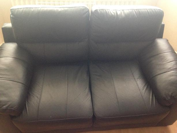 x2 black 2 seater leather sofas