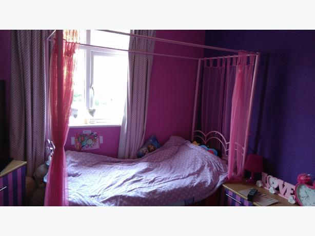Pink metal poster bed