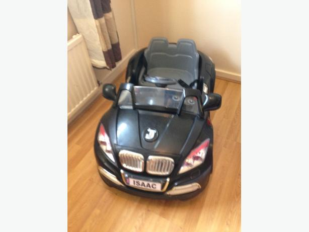 childs black electric car