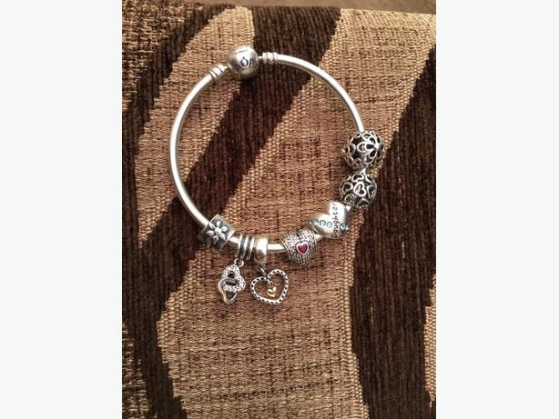 pandora bangle and 7 charms