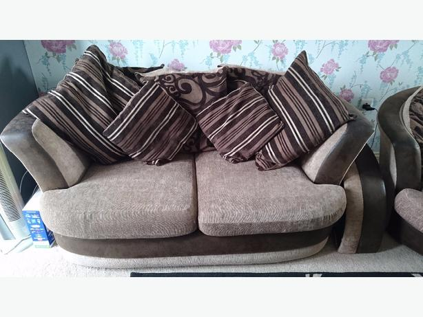 Brown sofa and swivel chair