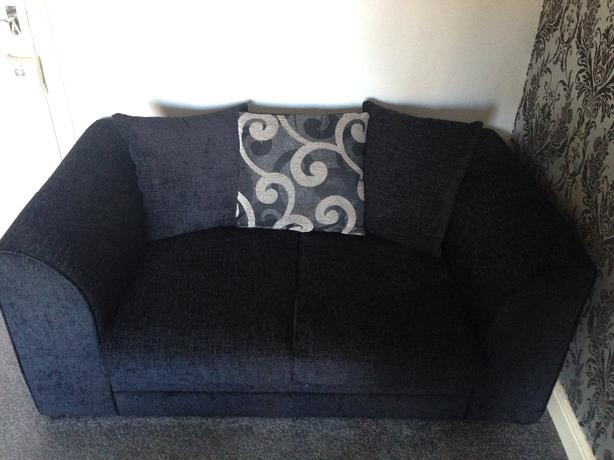 BARGAIN! Practically New!! Black 2 seater sofa £60 ono