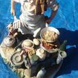 Large capo-de-Monte style chef figure on wooden base.
