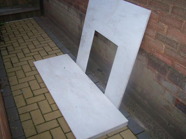 marble fire hearth and back plate