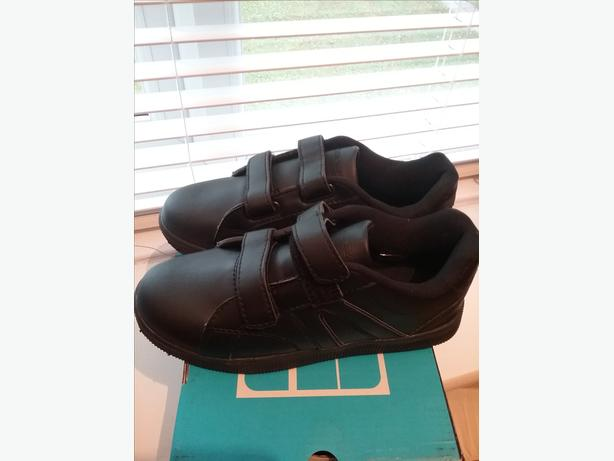 Black strap trainers