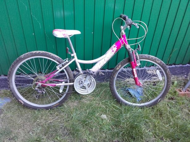 teenage girls mounting bike