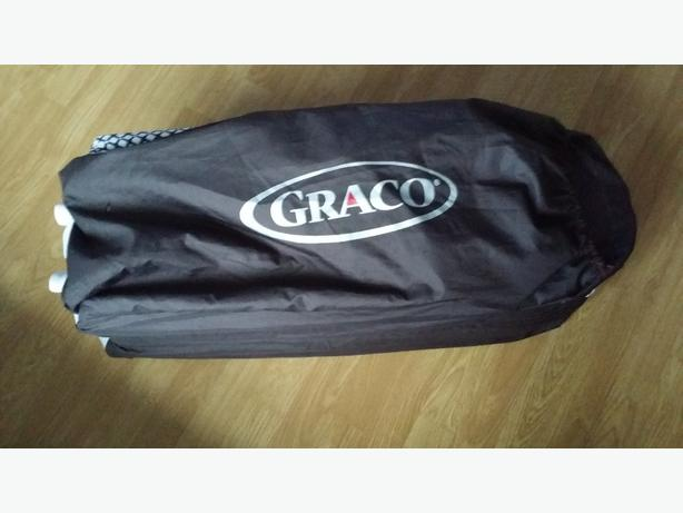 how to put up graco travel cot