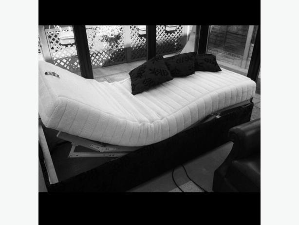 Electric bed with remote control