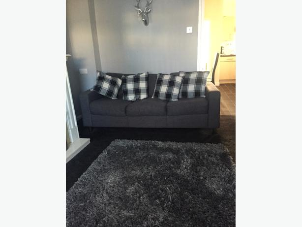 next grey fabric sofa 3 seater and 4 cushions
